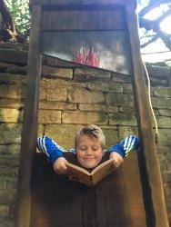 Alfie losing his head over a book.